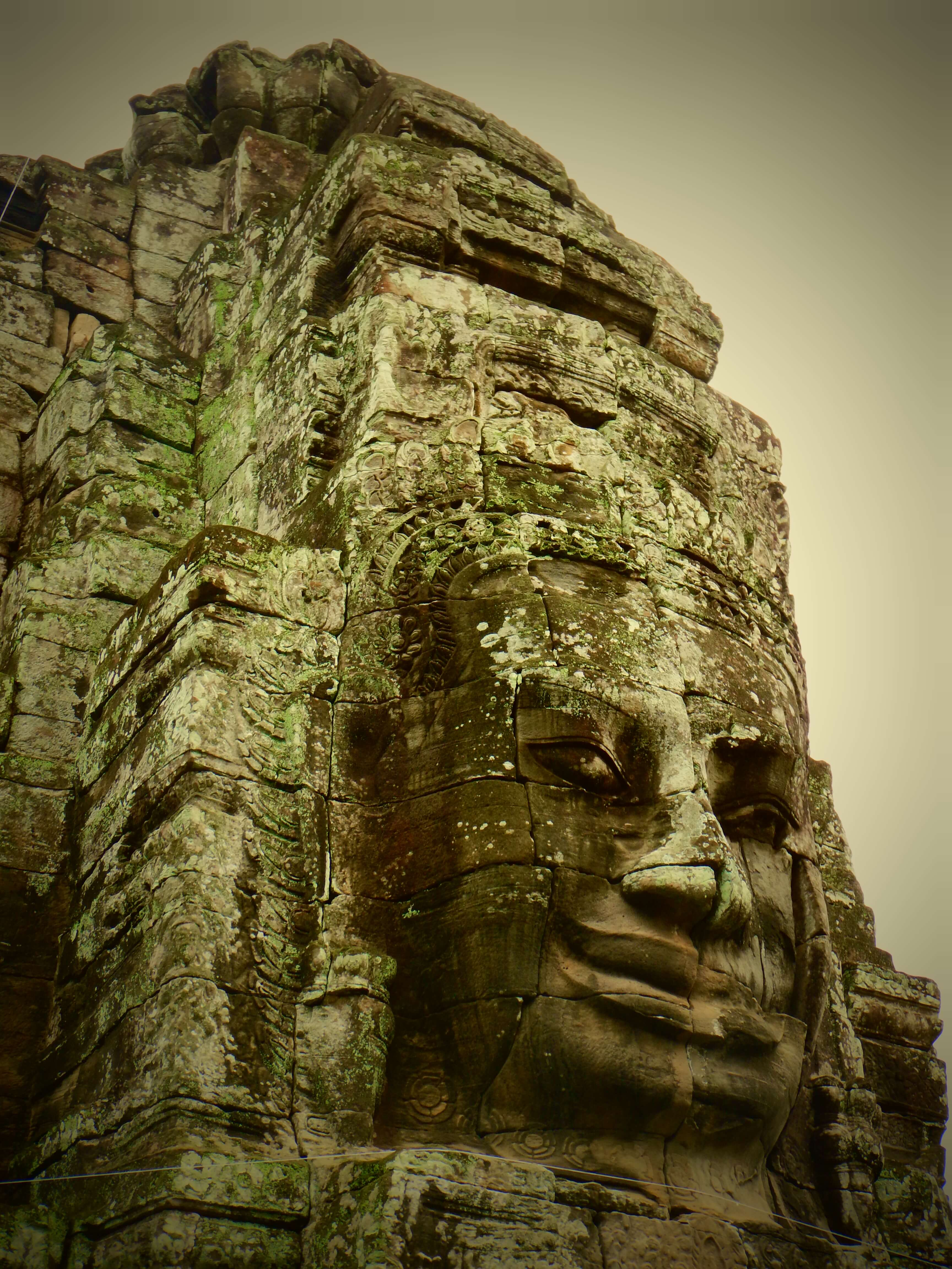 Catching the morning light on a face at Bayon Temple. Siem Reap, Cambodia.