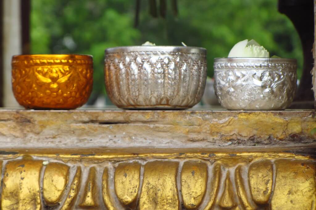 Three bowls sitting on a ledge at a temple. Phnom Penh, Cambodia.