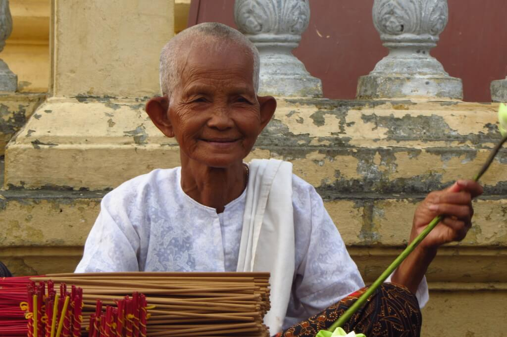 This lovely monk was sitting outside a temple. When I asked her if I could take her picture in Khmer, she happily obliged. Phnom Penh, Cambodia.