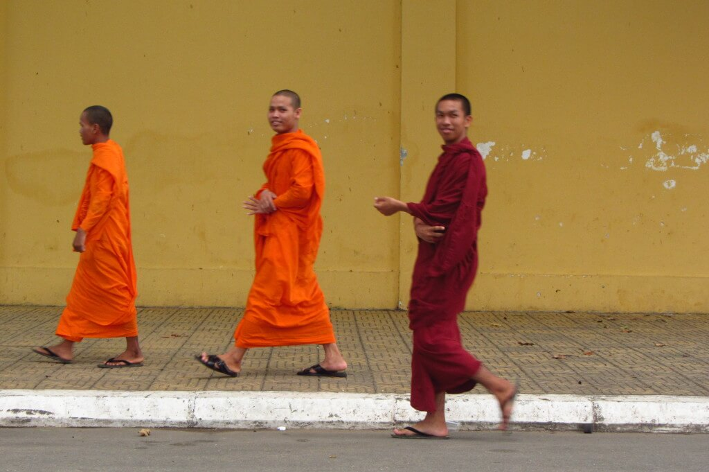 I saw monks walking my way off in the distance and waited in front of this bright yellow wall for them to walk by. Phnom Penh, Cambodia.