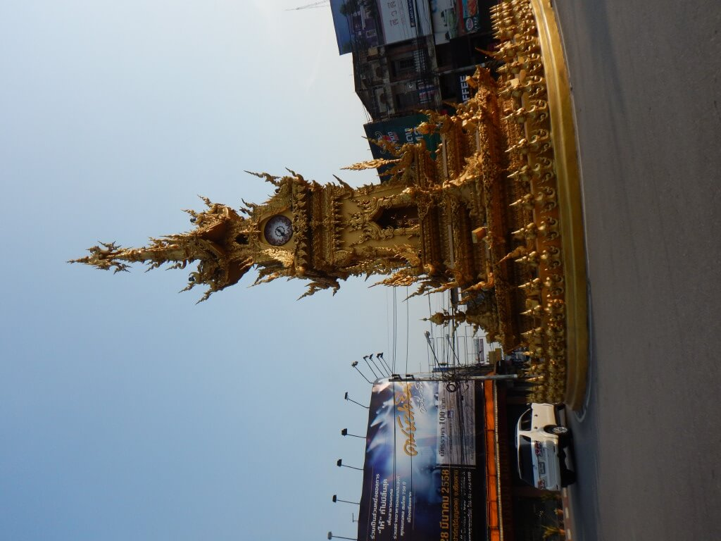The golden clock tower was designed by Chalermchai Kositpipat, the artist who created the White Temple.